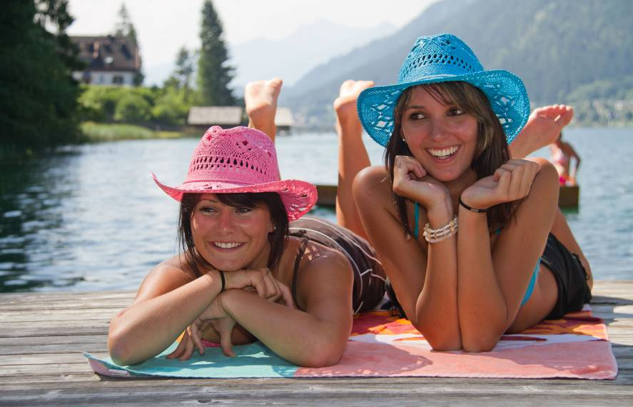 Two Women relaxing in the sun at Weissensee