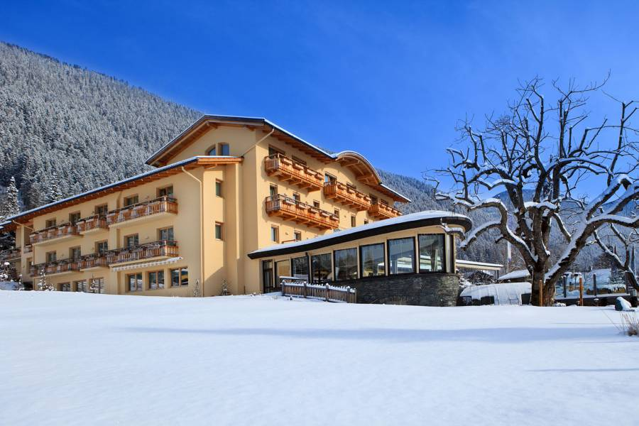 Strandhotel am Weissensee surrounded by snow